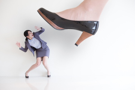 shoes woman: business woman steping on a fear woman, business concept , asian model Stock Photo