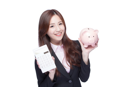 calculator chinese: smile young business woman hold calculator and piggy bank at white background, business concept, asian beauty Stock Photo
