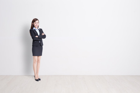 female beauty: business woman stand with white wall background, great for your design or text, asian