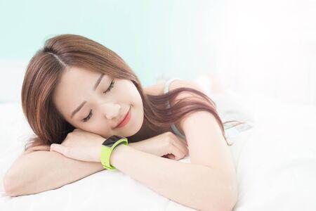 wellness sleepy: Charming woman sleep with wearable smart watch on the bed, health concept , asian girl Stock Photo