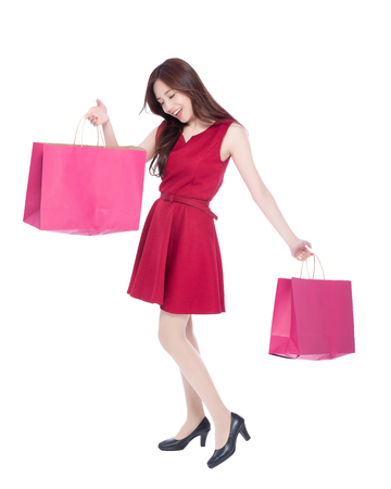 asian lady: happy shopping young woman show bags - isolated on white background, full body, asian beauty