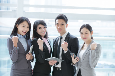 Business people team meeting with computer in the office, shot in Hong Kong, asian woman and man
