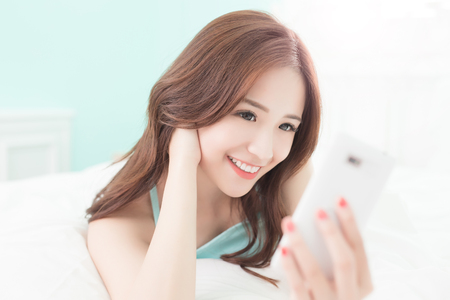 young lady: Health woman Smile take a selfie and she lying on the bed at home , asian girl