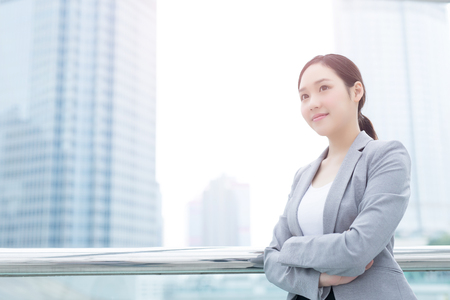 business woman smile and look with office background, asian beauty, shot in Hong Kong