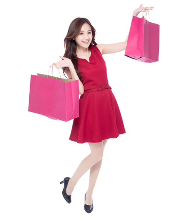 beauty full: happy shopping young woman show bags - isolated on white background, full body, asian beauty