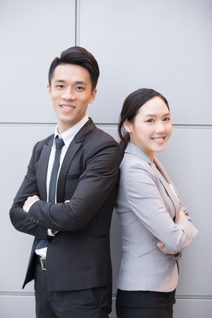 cross arms: Business people team smile to you in the office, shot in Hong Kong, asian woman and man Stock Photo