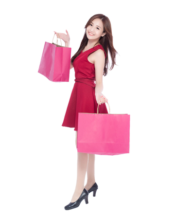 asia women: happy shopping young woman show bags - isolated on white background, full body, asian beauty