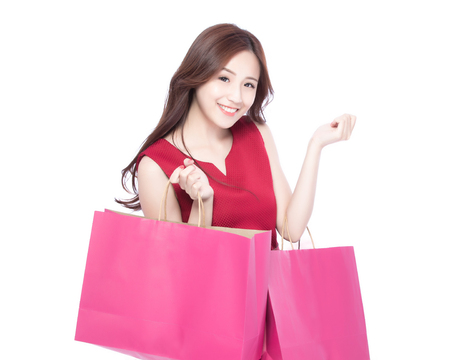 woman bag: happy shopping young woman show bags - isolated on white background, asian model beauty