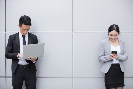 asian businesswoman: Business people team use smart phone and computer in the office, shot in Hong Kong, asian woman and man Stock Photo