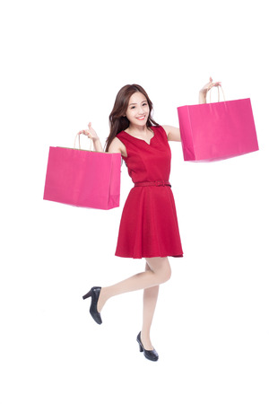 excited woman: happy shopping young woman show bags - isolated on white background, full body, asian beauty