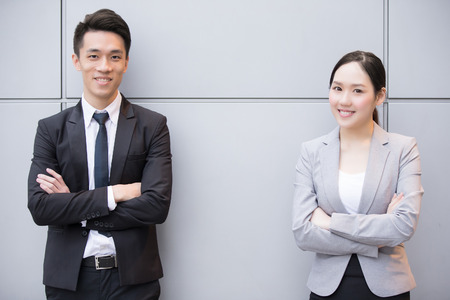 hk: Business people team smile to you in the office, shot in Hong Kong, asian woman and man Stock Photo