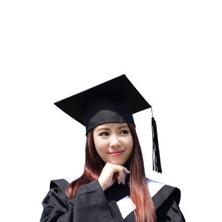gown: happy graduate student girl look up to copy space and feel carefree, she wear graduation cap and gown ,asian Stock Photo