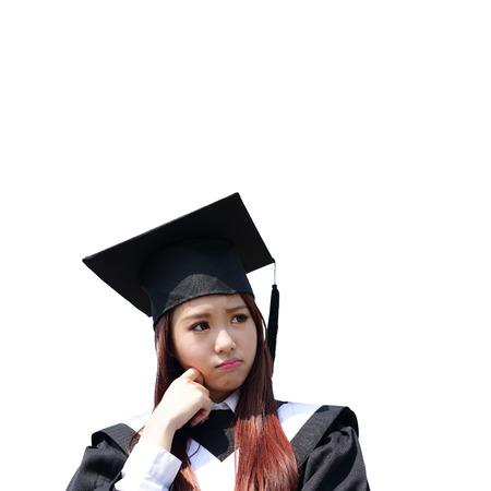 graduate: unhappy sad student woman graduating isolated on white background, asian beauty Stock Photo