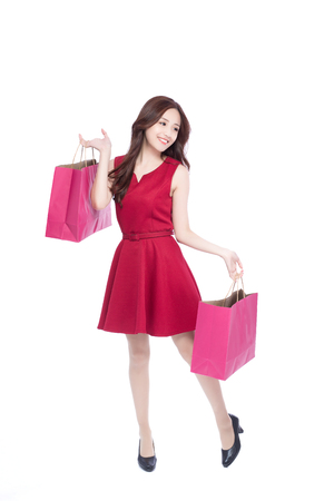 female christmas: happy shopping young woman show bags - isolated on white background, full body, asian beauty