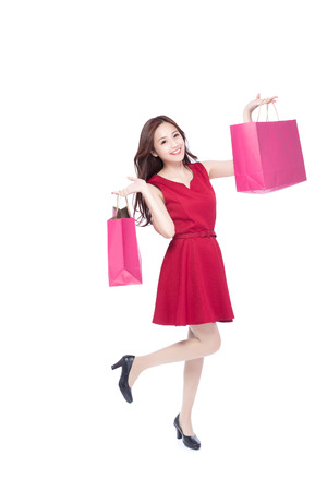 asian girl shopping: happy shopping young woman show bags - isolated on white background, full body, asian beauty