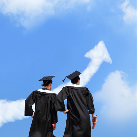 success asian: Back view of graduates student look arrow cloud in blue sky and think future