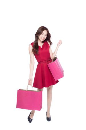 幸せなショッピング若い女表示バッグ - アジアの美しさ、全身白い背景に分離