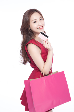 happy shopping: happy shopping young woman show bags and credit card - isolated on white background, asian model beauty Stock Photo