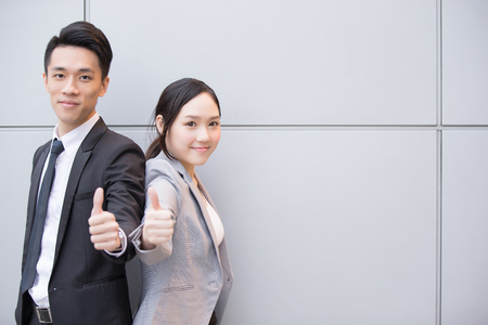 business asia: Business people team smile show thumb up in the office, shot in Hong Kong, asian woman and man Stock Photo