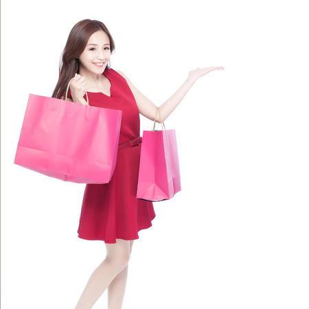 woman bag: happy shopping young woman show something - isolated on white background, asian model beauty