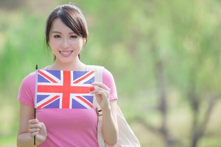 asian school girl: Happy College Student girl hold British flag with nature white background, asian