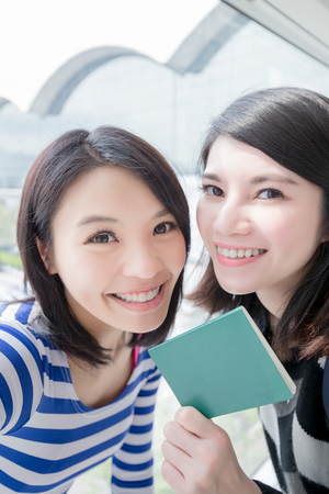 group shot: Happy group travel women hold passport and take a selfie. shot in hong kong, asian Stock Photo