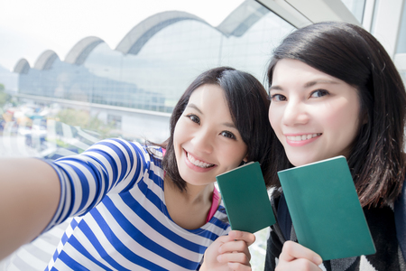 Happy group travel women hold passport and take a selfie. shot in hong kong, asian Stock Photo