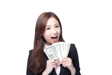 invest: business woman smile happy with handful of money isolated on white background, asian beauty model Stock Photo