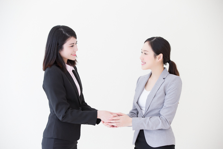 asian businesswoman: Group of success business people team shake hands in office with white background, asian