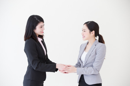 agreeing: Group of success business people team shake hands in office with white background, asian