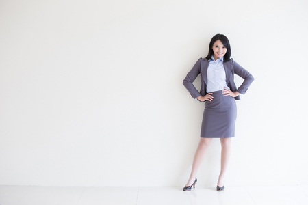 copyspace: business woman stand with white wall background, great for your design or text, asian