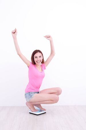 girl squatting: white girl squatting with her hands up