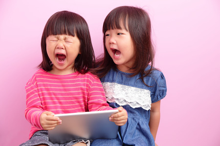 two little girls having argument crying ,Asian
