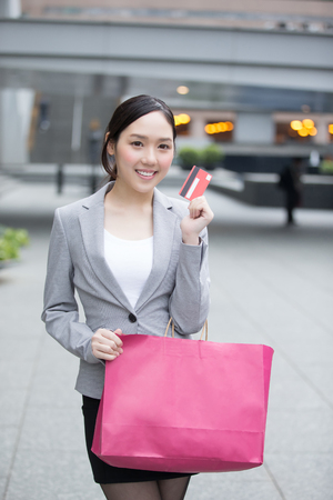 hon: businesswoman take a credit card and bag go shopping in hon kong, asian Stock Photo