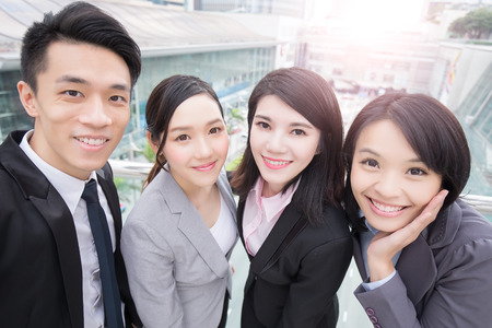 asia people: businesspeople are smile happily in hong kong, asian