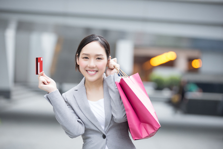 buy: businesswoman take a credit card and bag go shopping in hon kong, asian Stock Photo