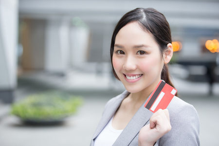 Office women: businesswoman take a credit card and go shopping in hon kong, asian