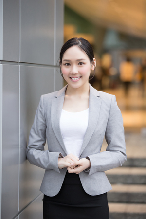 asian businesswoman: businesswoman is smile happily in the hon kong, asian