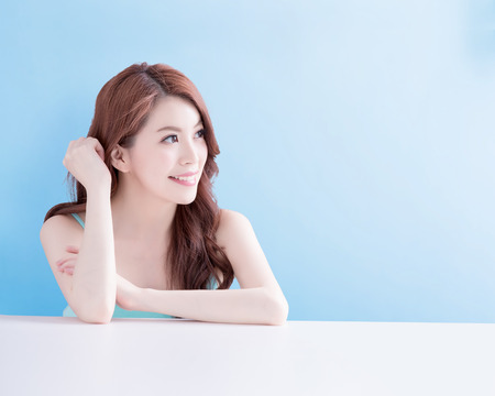 beauty woman smile and look you happily with isolated blue background, asian 写真素材
