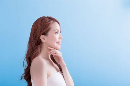 view girl: Beauty woman with charming smile to you with isolated blue background, asian