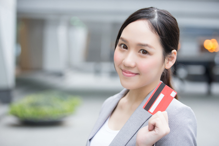 businesswoman take a credit card and go shopping in hon kong, asian