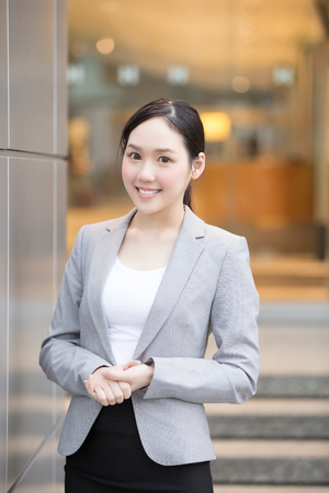 hon: businesswoman is smile happily in the hon kong, asian