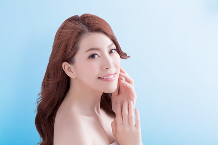 blue face: beauty skin care woman face with isolated blue background, asian Stock Photo