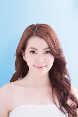 spa woman: Beauty woman with charming smile to you with isolated blue background, asian