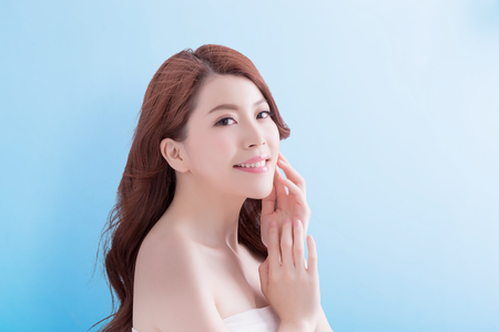 beauty skin care woman face with isolated blue background, asian Stock Photo