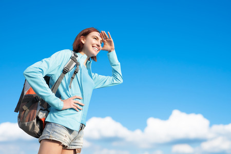 see: happy woman  mountain hiker go to travel and look something with blue sky and white clouds, caucasian Stock Photo