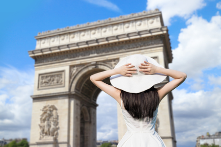 national monuments: young woman wear dress and behind you with Triumphal arch Stock Photo
