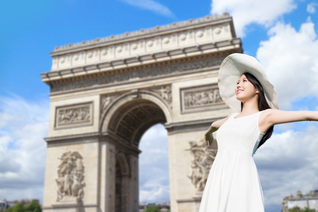 napoleon: young woman wear dress and smile with Triumphal arch Stock Photo
