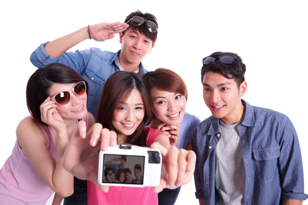 asian group: Happy teenagers taking pictures by themselves isolated on white background,asian