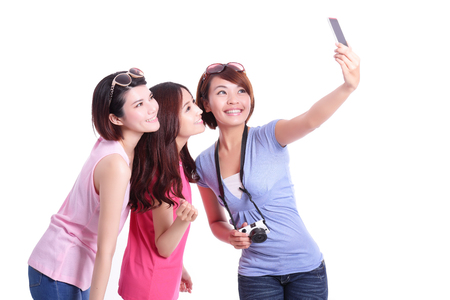camera girl: Happy teenagers woman taking pictures by themselves isolated on white background, asian